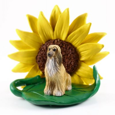 Afghan Hound Tan Figurine Sitting on a Green Leaf in Front of a Yellow Sunflower