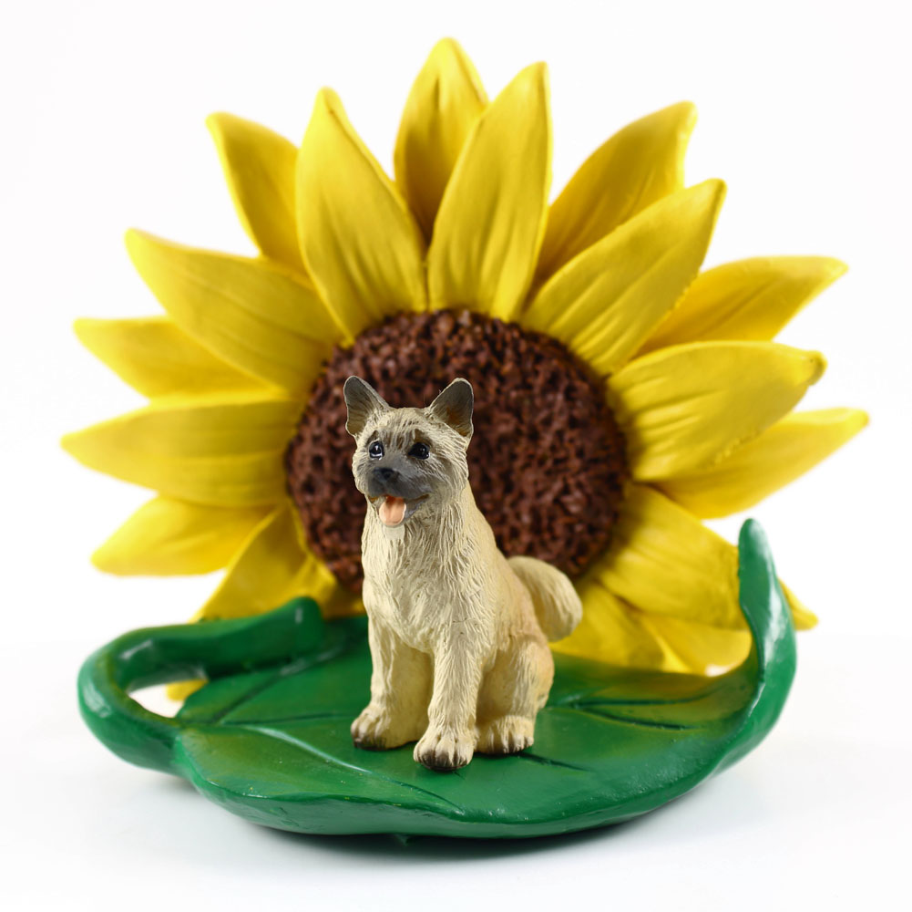 Akita Fawn Figurine Sitting on a Green Leaf in Front of a Yellow Sunflower