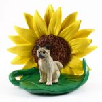 Akita Gray Figurine Sitting on a Green Leaf in Front of a Yellow Sunflower
