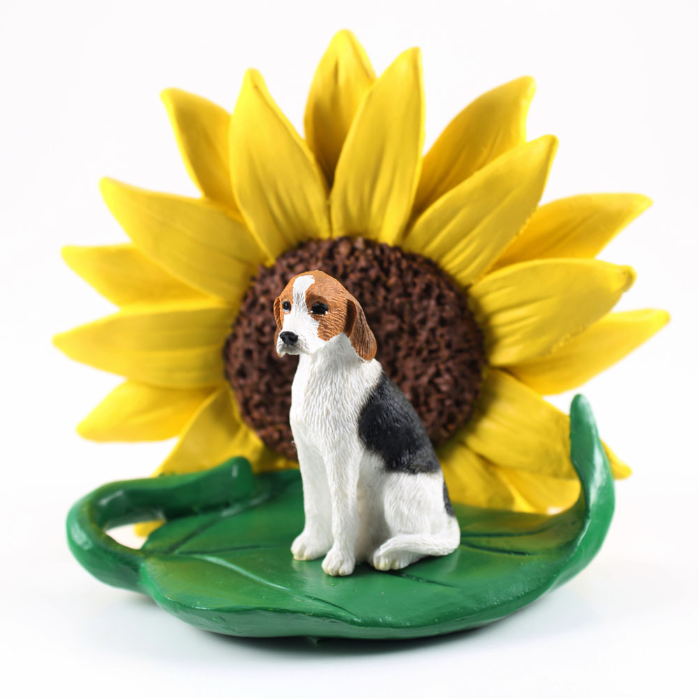 American Fox Hound Figurine Sitting on a Green Leaf in Front of a Yellow Sunflower