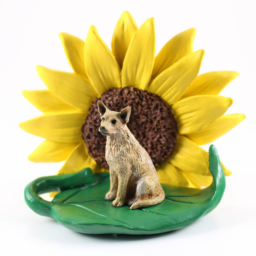 Australian Cattle Dog Red Figurine Sitting on a Green Leaf in Front of a Yellow Sunflower