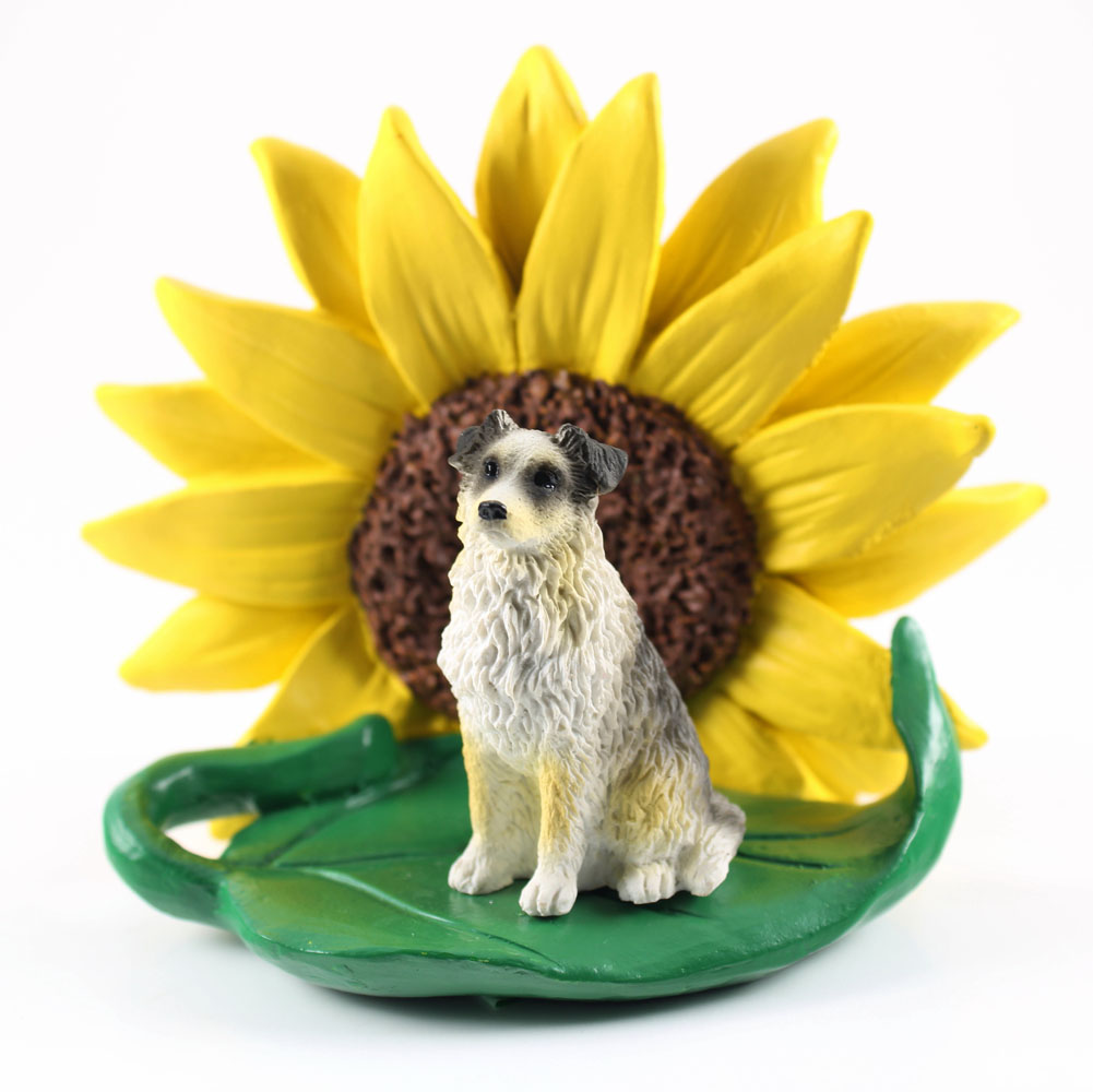 Australian Shepherd Blue Figurine Sitting on a Green Leaf in Front of a Yellow Sunflower