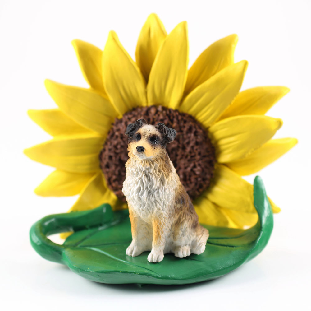 Australian Shepherd Brown Figurine Sitting on a Green Leaf in Front of a Yellow Sunflower
