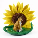 Basenji Figurine Sitting on a Green Leaf in Front of a Yellow Sunflower