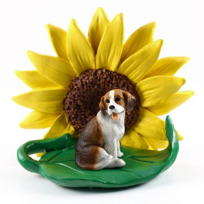 Beagle Figurine Sitting on a Green Leaf in Front of a Yellow Sunflower