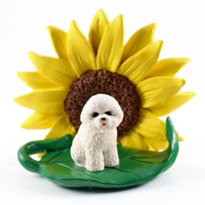 Bichon Frise Figurine Sitting on a Green Leaf in Front of a Yellow Sunflower