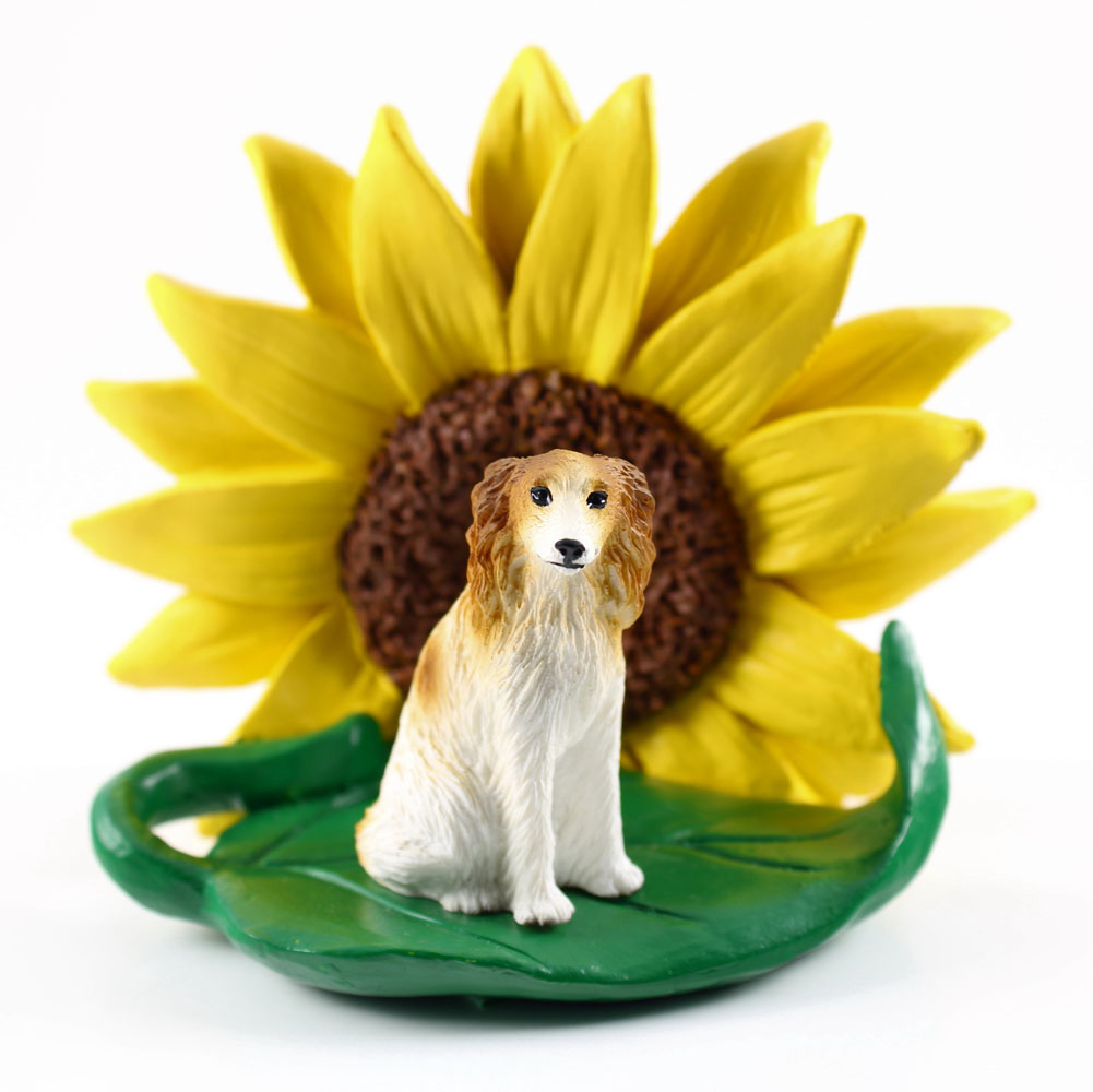Borzoi Figurine Sitting on a Green Leaf in Front of a Yellow Sunflower