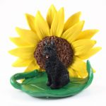 Bouvier Figurine Sitting on a Green Leaf in Front of a Yellow Sunflower