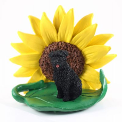 Bouvier Uncropped Figurine Sitting on a Green Leaf in Front of a Yellow Sunflower