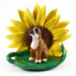 Boxer Figurine Sitting on a Green Leaf in Front of a Yellow Sunflower