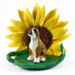 Boxer Brindle Figurine Sitting on a Green Leaf in Front of a Yellow Sunflower