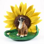 Boxer Uncropped Figurine Sitting on a Green Leaf in Front of a Yellow Sunflower