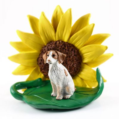 Brittany Brown/White Figurine Sitting on a Green Leaf in Front of a Yellow Sunflower