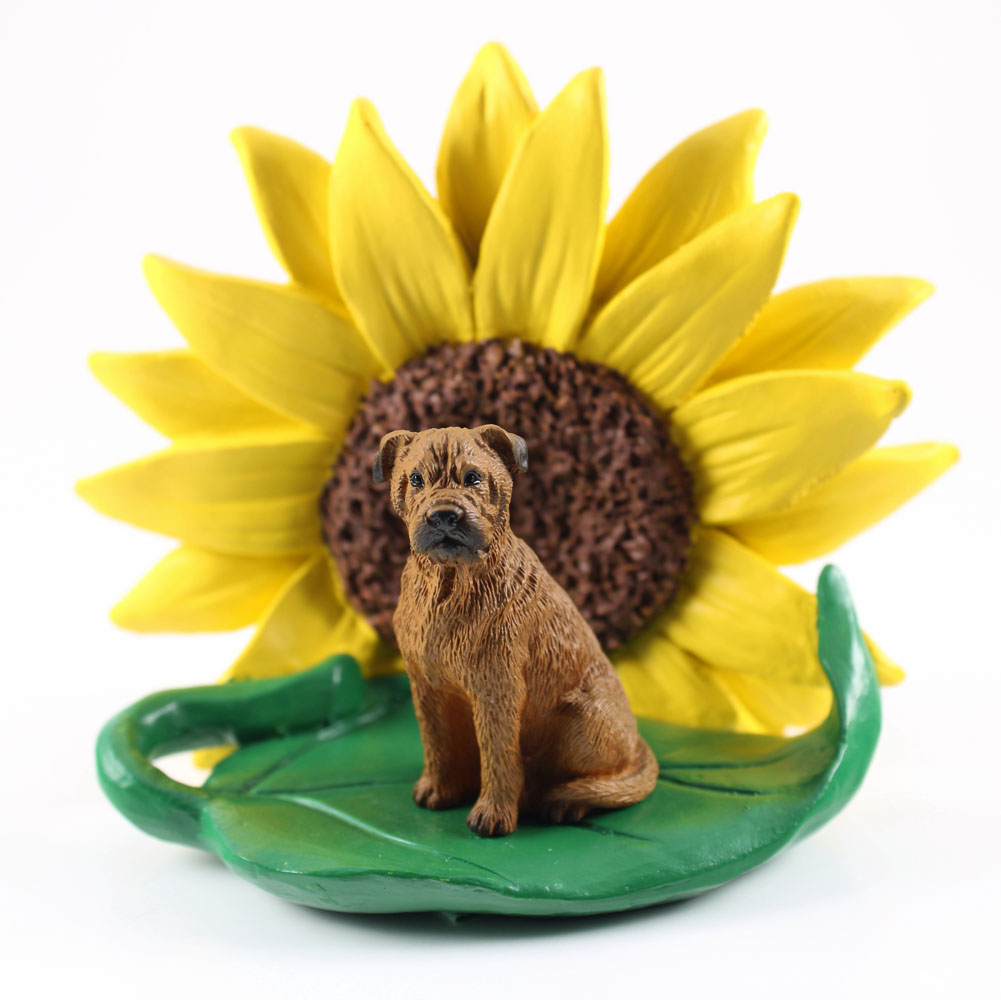 Bull Mastiff Figurine Sitting on a Green Leaf in Front of a Yellow Sunflower