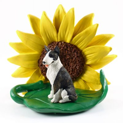 Bull Terrier Brindle Figurine Sitting on a Green Leaf in Front of a Yellow Sunflower