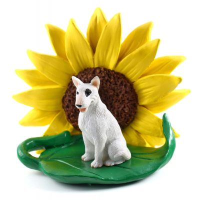 Bull Terrier White Figurine Sitting on a Green Leaf in Front of a Yellow Sunflower