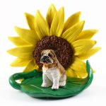 Bulldog Tan/White Figurine Sitting on a Green Leaf in Front of a Yellow Sunflower