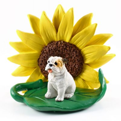 Bulldog White Figurine Sitting on a Green Leaf in Front of a Yellow Sunflower