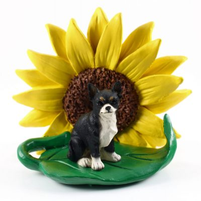 Chihuahua Black Figurine Sitting on a Green Leaf in Front of a Yellow Sunflower