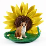 Chihuahua Brindle Figurine Sitting on a Green Leaf in Front of a Yellow Sunflower