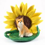 Chihuahua Longhair Figurine Sitting on a Green Leaf in Front of a Yellow Sunflower