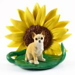 Chihuahua Figurine Sitting on a Green Leaf in Front of a Yellow Sunflower