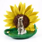 Chinese Crested Figurine Sitting on a Green Leaf in Front of a Yellow Sunflower