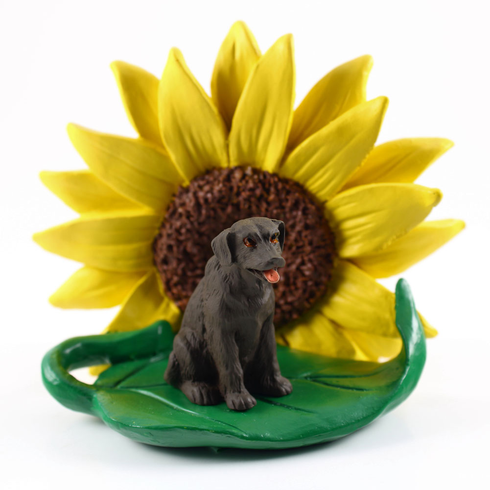 Chocolate Lab Figurine Sitting on a Green Leaf in Front of a Yellow Sunflower