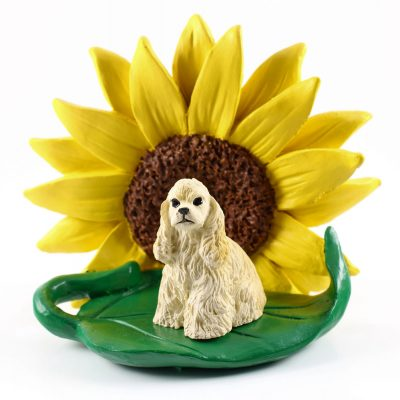 Cocker Spaniel Blonde Figurine Sitting on a Green Leaf in Front of a Yellow Sunflower
