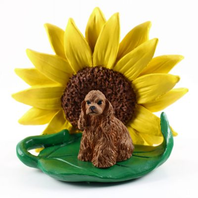 Cocker Spaniel Brown Figurine Sitting on a Green Leaf in Front of a Yellow Sunflower