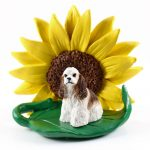 Cocker Spaniel Brown/White Figurine Sitting on a Green Leaf in Front of a Yellow Sunflower