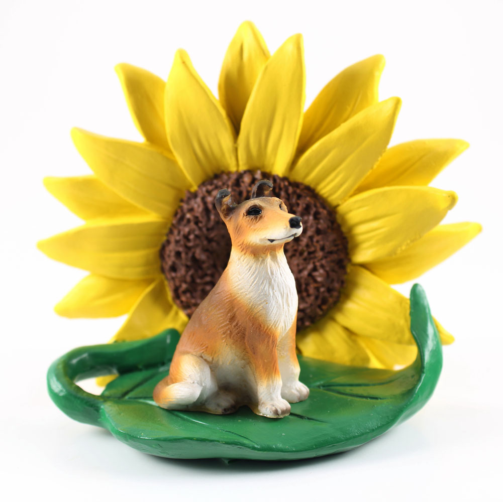Collie Smooth Figurine Sitting on a Green Leaf in Front of a Yellow Sunflower