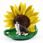 Corgi Cardigan Figurine Sitting on a Green Leaf in Front of a Yellow Sunflower
