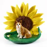 Corgi Pembroke Figurine Sitting on a Green Leaf in Front of a Yellow Sunflower