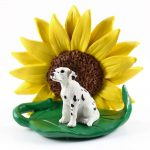 Dalmatian Figurine Sitting on a Green Leaf in Front of a Yellow Sunflower