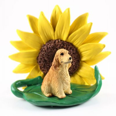 English Cocker Spaniel Blonde Figurine Sitting on a Green Leaf in Front of a Yellow Sunflower