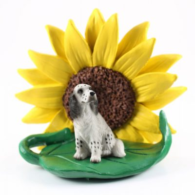 English Setter Blue Figurine Sitting on a Green Leaf in Front of a Yellow Sunflower