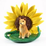 Finnish Spitz Figurine Sitting on a Green Leaf in Front of a Yellow Sunflower