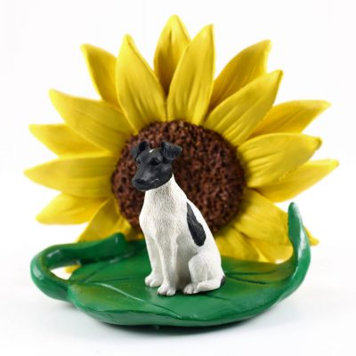 Fox Terrier Black Figurine Sitting on a Green Leaf in Front of a Yellow Sunflower