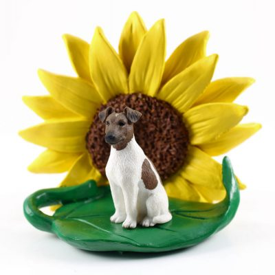 Fox Terrier Brown Figurine Sitting on a Green Leaf in Front of a Yellow Sunflower