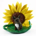 French Bulldog Brindle Figurine Sitting on a Green Leaf in Front of a Yellow Sunflower