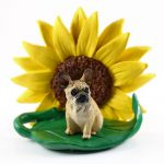 French Bulldog Cream Figurine Sitting on a Green Leaf in Front of a Yellow Sunflower