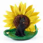 German Shepherd Black Figurine Sitting on a Green Leaf in Front of a Yellow Sunflower