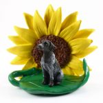 German Shorthair Pointer Figurine Sitting on a Green Leaf in Front of a Yellow Sunflower