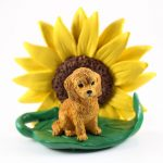 Goldendoodle Figurine Sitting on a Green Leaf in Front of a Yellow Sunflower