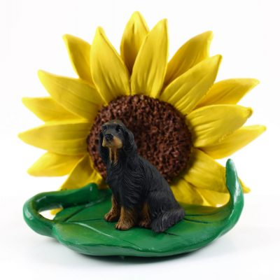 Gordon Setter Figurine Sitting on a Green Leaf in Front of a Yellow Sunflower