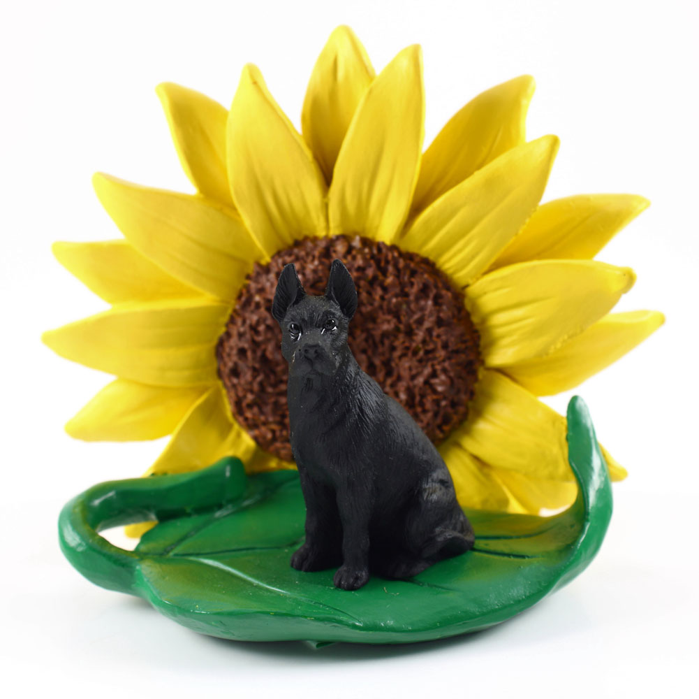 Great Dane Black Figurine Sitting on a Green Leaf in Front of a Yellow Sunflower