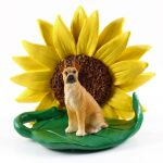 Great Dane Fawn Figurine Sitting on a Green Leaf in Front of a Yellow Sunflower