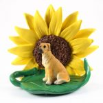 Great Dane Fawn Uncropped Figurine Sitting on a Green Leaf in Front of a Yellow Sunflower