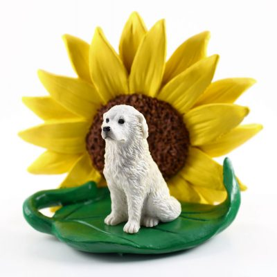 Great Pyrenees Figurine Sitting on a Green Leaf in Front of a Yellow Sunflower
